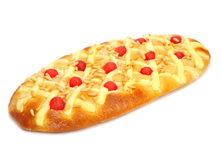 juan: a coca de Sant Joan, a typical sweet flat cake from Catalonia, Spain, eaten on Saint Johns Eve, on a white background Stock Photo