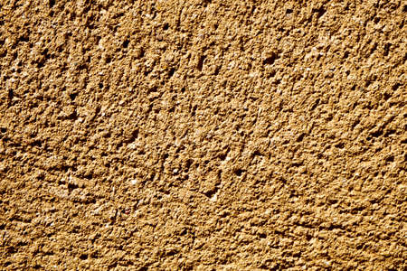 stonemasonry: background made from a closeup of a rough limestone surface