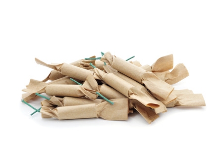 sant: some brown firecrackers with green fuse on a white background