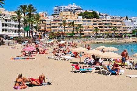 bathers: Ibiza Spain  June 19 2015: Sunbathers in the popular Ses Figueretes Beach in Ibiza Town Spain. Ibiza is a wellknown summer tourist destination in Europe