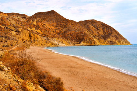 spanish landscapes: a view of the Algarrobico Beach, in Carboneras, in the Cabo de Gata-Nijar Natural Park, in the Province of Almeria, in Spain