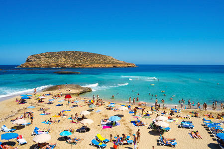 ibiza: San Antonio, Spain- June 15, 2015: Sunbathers at Cala Conta beach in San Antonio, in Ibiza Island, Spain. Ibiza is a well-known summer tourist destination in Europe Editorial