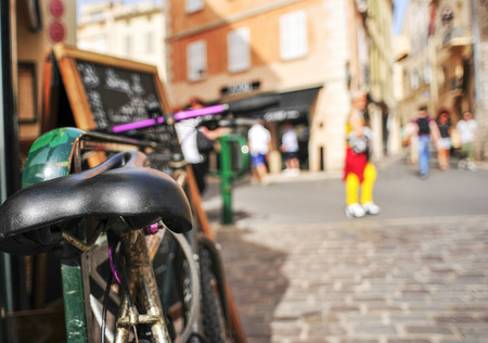 closeup of a worn-out bicycle in a pedestrian street in Saint-Tropez, France, with a filtered effect Archivio Fotografico