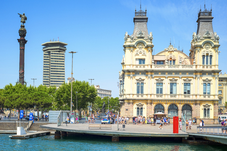 colom: Barcelona, Spain - July 4, 2015: Port Vell and Columbus Monument in Barcelona, Spain. It is a 60 meters tall monument for Christopher Columbus at the lower end of La Rambla