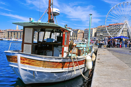 old port: Marseille, France - May 17, 2015: Sunday ambiance at the Old Port in Marseille, France. It is a busy port, used as a marina and as a terminal for boat trips, and hosts a fish market