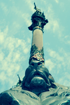 wanderlust: a view of the Columbus Monument in Barcelona, Spain, seen from below, with a retro effect