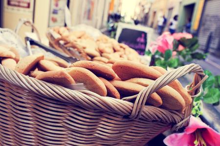 boulangerie: closeup of a wicker basket with cookies on sale in the old town of Marseille, France Stock Photo