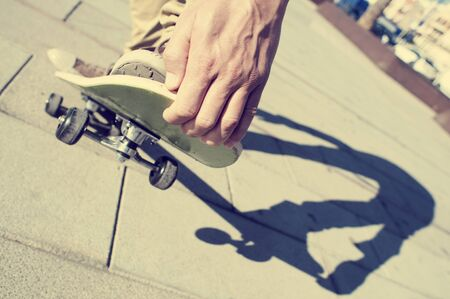 skateboard: closeup of a young man performing a trick with his skateboard, with a filter effect Stock Photo