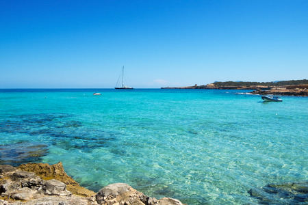 ibiza: detail of the clear seawater at Cala Conta beach in San Antonio, Ibiza Island, Spain