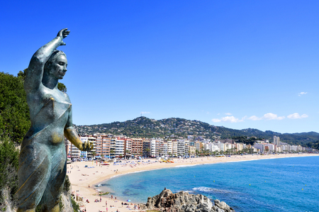 mar: Lloret de Mar, Spain - May 22, 2015: A panoramic view of Platja de Lloret beach in Lloret de Mar, Spain. It is the main beach in this popular tourist village in the Costa Brava, in Catalonia Editorial