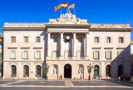 generalitat: Barcelona, Spain - July 10, 2015: A view of the City Hall of Barcelona in Barcelona, Spain. This historic building faces the Palau de la Generalitat, the seat of the autonomic government