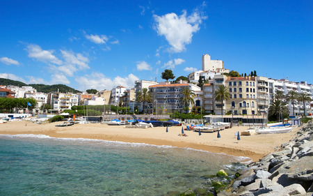 sant: Sant Pol, Spain - May 23, 2015: A view of Platja de les Barques beach and the Ermita de Sant Pau in the top of the hill on in Sant Pol, Spain. Boats, barques in Catalan, give name to this beach
