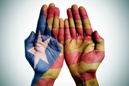 separatist: the hands of a man patterned with the Estelada, the Catalan pro-independence flag
