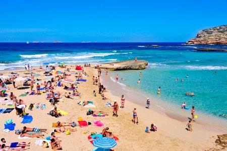 antonio: San Antonio, Spain - June 15, 2015: Sunbathers at Cala Conta beach in San Antonio, in Ibiza Island, Spain. Ibiza is a well-known summer tourist destination in Europe Editorial