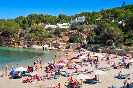destinations: San Antonio, Spain - June 18, 2015: Sunbathers at Cala Gracio beach in San Antonio, in Ibiza Island, Spain. Ibiza is a well-known summer tourist destination in Europe Editorial
