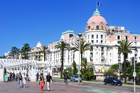 promenade: Nice, France - May 16, 2015: The famous Le Negresco Hotel in Nice, France. This historic luxury hotel, located in the Promenade des Anglais, is a landmark in the city Editorial