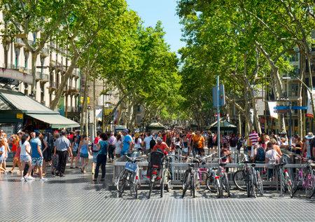 la: Barcelona, Spain - July 10, 2015: A crowd in La Rambla in Barcelona, Spain. Thousands of people walk daily by this popular pedestrian mall 1.2 kilometer-long