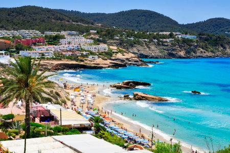 sant: Sant Josep, Spain - June 15, 2015: Panoramic view of Cala Tarida beach in Sant Josep de Sa Talaia, in Ibiza Island, Spain. Ibiza is a well-known summer tourist destination in Europe Editorial
