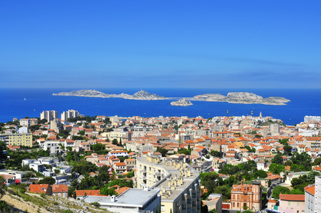 isles: aerial view of Marseille, France, from Notre-Dame de la Garde, with the Mediterranean sea and Les Isles islands in the background Stock Photo