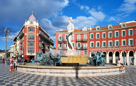Nice, France - May 15, 2015: A view of the fountain Fontaine du Soleil at the Place Massena square in Nice, France. The Place Massena is the main public square in the town Editorial