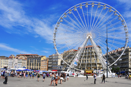 city fish market: Marseille, France - May 17, 2015: Sunday ambiance and Ferris wheel at the Old Port in Marseille, France. It is a busy port, used as a marina and as a terminal for boat trips