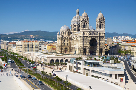 cathedrale: Marseille, France - May 17, 2015: The Cathedral of Saint Mary Major in Marseille, France. The Musee Regards de Provence, in the foreground, shows the historical artworks from Provence
