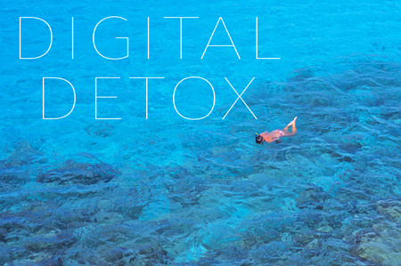 detox: the text digital detox in a sea landscape with someone diving