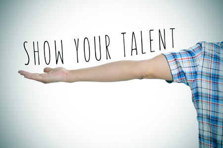 talent: a young caucasian man and the text show your talent in his outstretched arm, slight vignette added