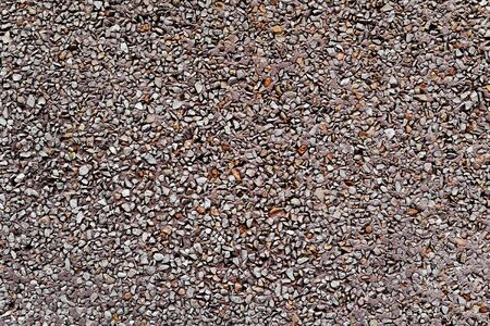 background made of a closeup of a wall plastered with a dry dash aggregates coating Stok Fotoğraf
