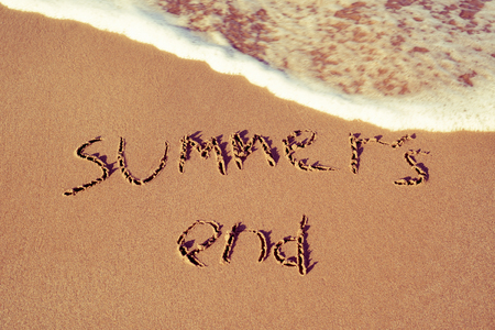 vac: the text summers end written in the sand of a beach Stock Photo