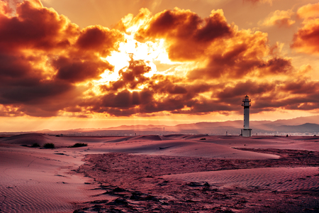 ebre: a view of the lighthouse at El Fangar, in the Ebro Delta, in Spain, in a cloudy day Stock Photo