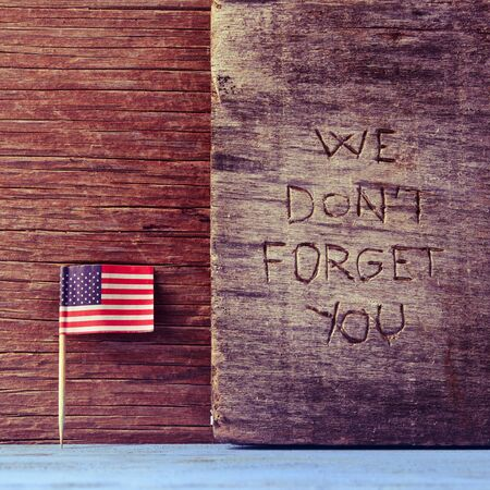 not forget: the flag of the United States and the sentence we do not forget you carved on wood Stock Photo