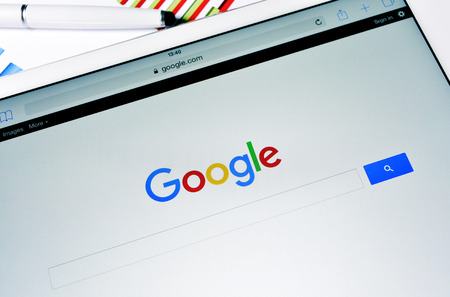 september 2: Barcelona, Spain - September 2, 2015: A tablet computer with the Google Web Search homepage in its screen with the new Google logo, launched in September 1, 2015