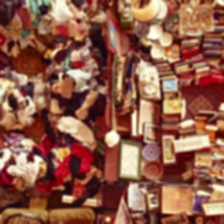 half stuff: defocused blur background of an aerial view of a stall in a flea market full of bits and pieces