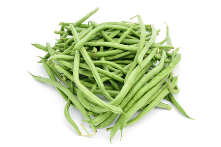 french bean: a pile of raw green beans on a white background