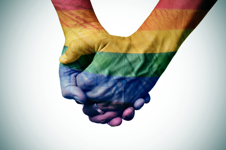 closeup of a gay couple holding hands, patterned as the rainbow flag