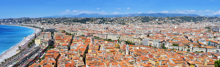 bordering: a panoramic view of Nice, France, and the Promenade des Anglais bordering the Mediterranean Sea at the Baie des Agnes bay