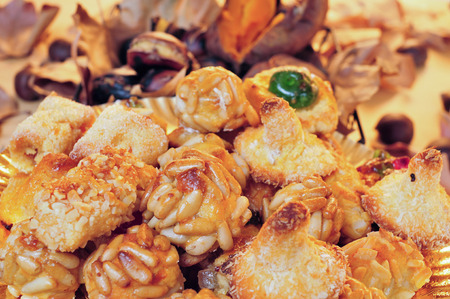 panellets: closeup of a plate with panellets, and some roasted chestnuts and sweet potatoes, a typical snack in All Saints Day in Catalonia, Spain