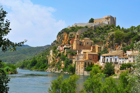 ebre: view of the Ebro River and the old town of Miravet, Spain, highlighting the Templar castle in the top of the hill Stock Photo