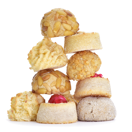 panellets: a pile of different panellets, typical pastries of Catalonia, Spain, eaten in All Saints Day, on a white background Stock Photo
