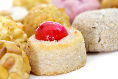 all saints day: closeup of some different panellets, typical pastries of Catalonia, Spain, eaten in All Saints Day