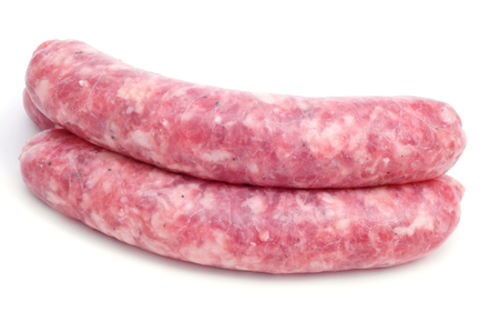 longaniza: closeup of some uncooked pork meat sausages on a white background Stock Photo