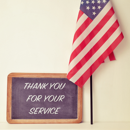 thankfulness: the text thank you for your service written in a chalkboard and a flag of the United States