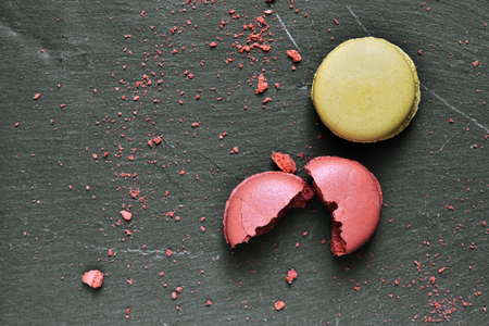 flavors: some appetizing macarons of different flavors on a slate surface