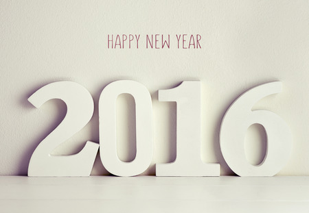 0 1 year: three-dimensional white numbers forming the number 2016 on a white surface against a white background and the text happy new year written in red Stock Photo