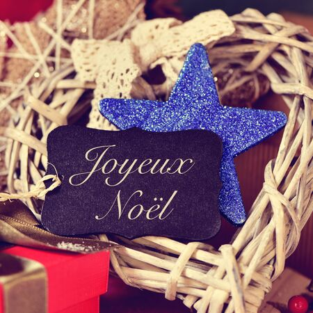 bonnie: a black label with the text joyeux noel, merry christmas in french, on a pile of gifts and different bonnie christmas ornaments
