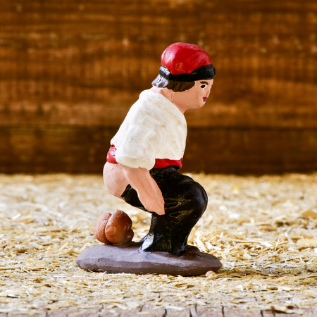 closeup of the caganer, a typical catalan character in the nativity scenes of Catalonia, Spain depicting a catalan peasant defecating Stock Photo