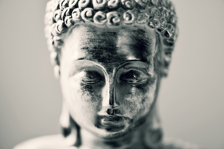 duotone: closeup of the face of a representation of the buddha in duotone Stock Photo