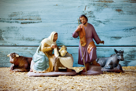joseph: the holy family, Child Jesus, the Virgin Mary and Saint Joseph, and the donkey and the ox in a rustic nativity scene