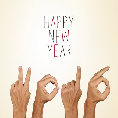 0 1 year: man hands forming the number 2016, as the new year, and the text happy new year on a beige background